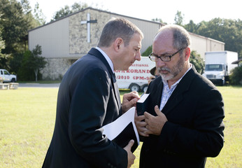 Reverend Rob Schenck of the National Clergy Council talks with Reverend Patrick Mahoney of the Christian Defense Coalition after speaking with Dove World Outreach Center church pastor Terry Jones