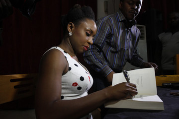Nigerian novelist Chimamanda Ngozi Adichie signs an autograph after a reading of her new book 'Americanah' in Lagos