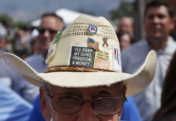 Supporter of Republican U.S. presidential candidate Romney wears hat as he stands during campaign stop at Tom's Ice Cream Bowl in Zanesville