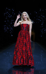 Annasophia Robb presents a creation by Alice and Olivia for the The Heart Truth Fall 2014 collection during New York Fashion Week