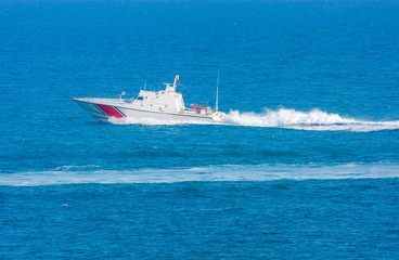 Coast Guard patrol boat rushing to the rescue