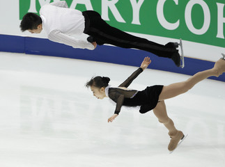 Takahashi and Tran of Japan perform during the pairs short program competition at the ISU World Figure Skating Championships in Moscow