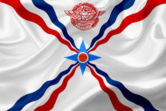 Flag of Assyria, with waving fabric texture