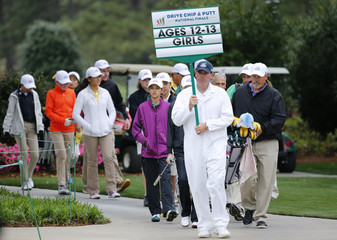 Girls take part in the Drive Pitch and Putt contest before the Masters golf tournament at the Augusta National Golf Club