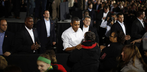 U.S. President Obama speaks with member of audience during a campaign rally at Mentor High School in Ohio