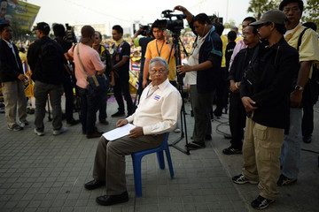 Protest leader Suthep Thaugsuban prepares to address anti-government protesters as they take part in birthday celebrations for Thailand's revered King Bhumibol Adulyadej, in Bangkok