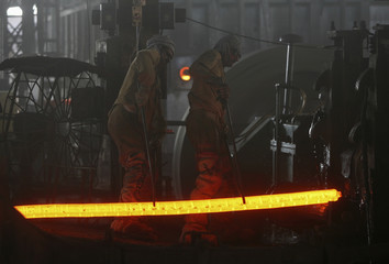 Labourers work inside iron factory on the outskirts of Jammu