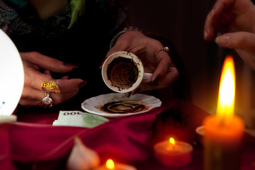 Empty coffee cup in hands of fortune teller