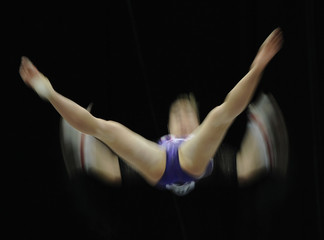 Kaeslin of Switzerland competes on the uneven bar at the qualifying round of the Gymnastics World Championships at the Ahoy Arena in Rotterdam