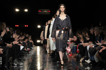 Models present creations by French designer Guillaume Henry as part of his Fall-Winter 2013/2014 women's ready-to-wear fashion show for house Carven in Paris