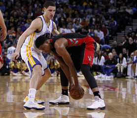 Toronto Raptors Rudy Gay works with the ball against Golden State Warriors Klay Thompson during the second quarter of their NBA basketball game in Oakland