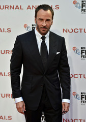 """Director Tom Ford poses as he arrives for the gala screening of the film """"Nocturnal Animals"""" during the 60th BFI London Film Festival at Leicester Square in London"""