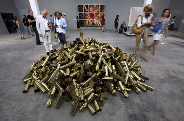 Visitors look at an art installation by Kris Martin of Belgium at the 12th Istanbul Biennial