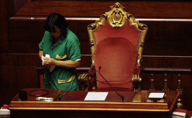 A worker cleans President's desk at the Senate before PM Letta's address in morning asking for possible call for confidence vote immediately in Rome