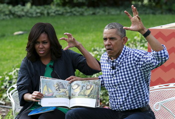 "President Barack Obama and first lady Michelle Obama perform a reading of the children's book ""Where the Wild Things Are\"