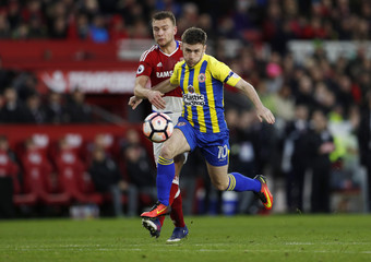 Accrington Stanley's Shay McCartan in action with Middlesbrough's Ben Gibson