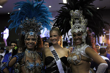Miss Serbia 2011 Saranovic poses for a photograph with members of Vila Maria samba school in Sao Paulo