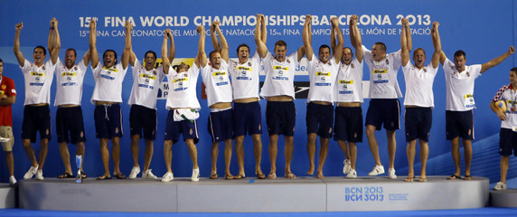 Gold medallists team Hungary celebrate on the podium during the victory ceremony after winning the men's water polo gold medal match in the World Swimming Championships in Barcelona