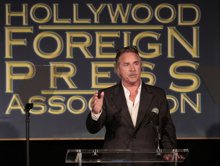 Johnson speaks at The Hollywood Foreign Press Association's annual luncheon to announce financial grants to film schools and non-profit organizations at the Beverly Hills hotel in Beverly Hills
