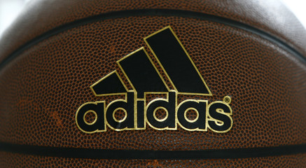 Adidas logo is pictured on basketball in Herzogenaurach
