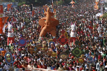People carry masks and a replica of an elephant during a rally to celebrate Pohela Boishakh, the first day of Bengali new year in Dhaka.