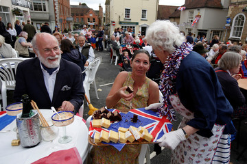 Residents gather together to celebrate in the main square, at Petworth