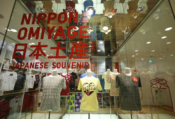 T-shirts are displayed at Fast Retailing's Uniqlo casual clothing store in Tokyo