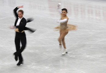 Madison Chock and Evan Bates of the U.S. compete during the ice dance short dance program at the ISU World Figure Skating Championships in Saitama