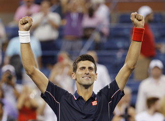 Djokovic of Serbia celebrates after defeating Murray of Britain in their quarter-final men's singles match at the 2014 U.S. Open tennis tournament in New York