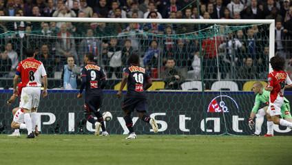 Paris Saint-Germain's Hoarau scores against Monaco during their French Cup final soccer match at the Stade de France in Saint-Denis