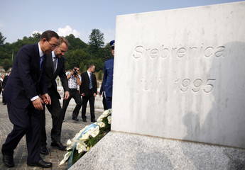U.N. Secretary General Ban and Chairman of the Tripartite Bosnian Presidency Izetbegovic lay flowers in Potocari