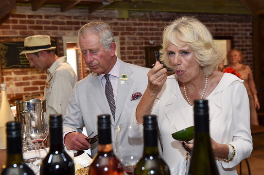 Britain's Prince Charles and his wife Camilla, Duchess of Cornwall, taste local produce at Oranje Tractor Centre in Albany