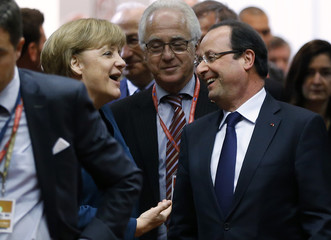 Germany's Chancellor Merkel and France's President Hollande arrive at a European Union leaders summit in Brussels