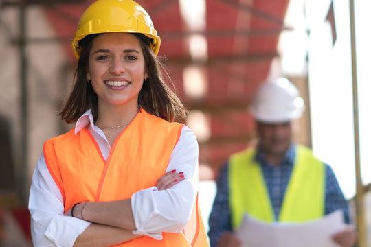 Portrait of confident female construction worker at construction site