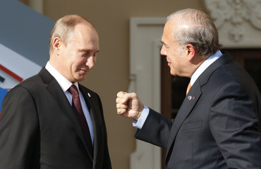 Russia's President Putin welcomes Gurria, secretary-general of the Organisation for Economic Co-operation and Development (OECD) at the G20 Summit in Strelna near St. Petersburg