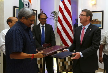 U.S. Defence Secretary Carter and India's Defence Minister Parrikar shake hands after signing of agreements ceremony in New Delhi