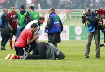 USM Alger's coach Rolland Corbis prays after his team won their Algeria Cup final soccer match against MC Alger in Algiers