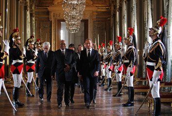 South African President Zuma and Mayor of Paris Delanoe walks past honour guards during a visit at the City Hall in Paris in Paris
