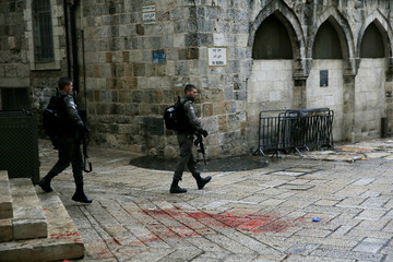Israeli border policemen patrol near the scene of a what an Israeli police spokesperson said was a Palestinian stabbing attack in Jerusalem's Old City