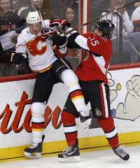 Senators Smith hits Flames Babchuk during their NHL hockey game in Ottawa