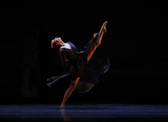 "A dancer of Spain's National Dance Company performs ""Arenal"", choreographed by Nacho Duato, during a rehearsal in Madrid"