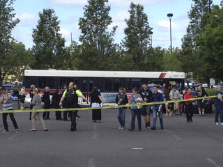 Students leave buses to be reunited with their parents after a shooting at Reynolds High School in Troutdale, Oregon
