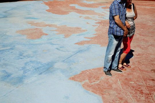 A couple have their photo taken standing on a map of Europe at Parque Europa (Europe Park) in Torrejon de Ardoz, outside Madrid