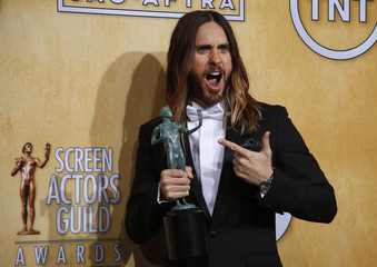 Jared Leto poses with his award at the 20th annual Screen Actors Guild Awards in Los Angeles