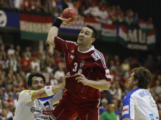 Hungary's Ilyes tries to score against Slovenia's Spiler and Miklavcic during their Men's European Handball Championship main round match in Novi Sad