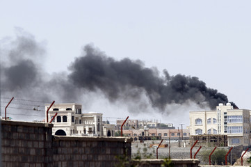 Smoke rises from residential buildings near the army's First Armoured Division which came under attack from Shi'ite Houthi militants, in Sanaa