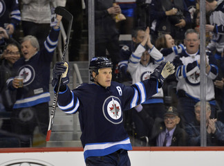 Jets' Jokinen celebrates his goal against the Hurricanes during their NHL hockey game in Winnipeg
