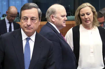 ECB President Draghi, Ireland's Finance Minister Noonan and his Finnish counterpart Urpilainen attend an eurozone finance ministers meeting in Brussels