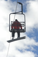 Snowboarder Riding On Lift