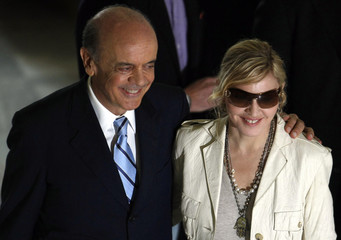 U.S. singer Madonna and Sao Paulo's governor Serra pose for a photograph after their meeting at Bandeirantes Palace in Sao Paulo